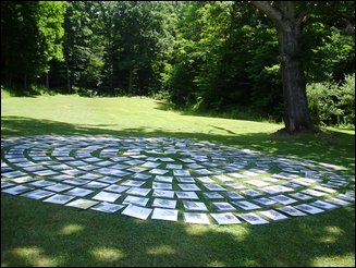 Portraits laid out in fan pattern in grass.