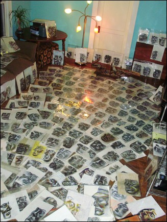 Portraits laid out on a floor.
